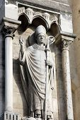 PARIS, FRANCE - NOV 05,2012: Pope statue, architectural detail of Cathedral Notre Dame de Paris, mos