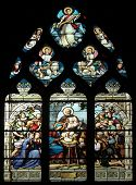 PARIS,FRANCE - NOV 11, 2012:Nativity Scene,adoration of the shepherds,stained glass.The Church of St