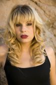Beautiful blonde model in a black tank top