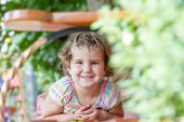 outdoor portrait of young cute child girl on natural background
