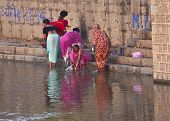 Morning Bathing And Cleaning On The Betwa River Ghat.
