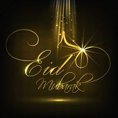 Shiny golden text Eid Mubarak on black background for Muslim community festival Eid Mubarak celebrat