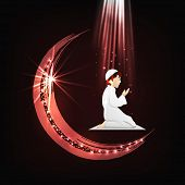 Religious muslim boy praying on glossy crescent moon background for Muslim community festival Eid Mu