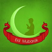 Beautiful Eid Mubarak celebrations poster, banner or flyer design with silhouetted of a muslim boy p