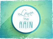 Beautiful sticky with stylish text Love the Rain on grungy green background.