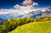 Majestic view of alpine meadows with blue sky at the foot of  Mt. Ushba. Upper Svaneti, Georgia, Eur