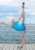 image of leg-split  - Happy girl stretching out making vertical split - JPG