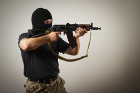 stock photo of terrorist  - Man in mask with gun. Russian terrorist. ** Note: Soft Focus at 100%, best at smaller sizes - JPG