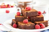stock photo of brownie  - Homemade chocolate brownies decorated with fresh raspberry - JPG