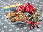 Home-made christmas gingerbread cookies on plate with seasonal decoration