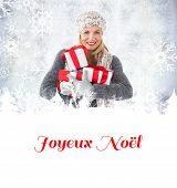 happy blonde with gifts against joyeux noel