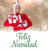 happy festive blonde with gift against feliz navidad