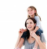 Cheerful Mother Giving Piggyback Ride To Her Daughter