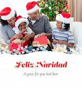 Happy family opening Christmas presents against feliz navidad