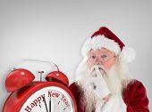 Santa asking for quiet to camera against grey vignette