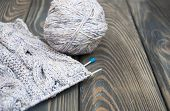 Knitting On Rustic Wooden Background