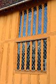 Window on orange half timbered house