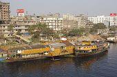 Sadarghat boat terminal and riverside residential area, Dhaka, Bangladesh.