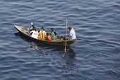 Residents of Dhaka cross Buriganga river by boat in Dhaka, Bangladesh.