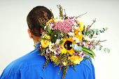 Man holds bouquet of flowers for the head
