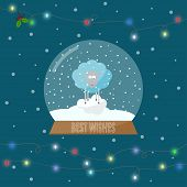 Glass Bowl With Snow And blue Sheep And Lights On The Garland For Winter Holidays Greeting Card