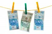 Polish Zloty Banknotes On Clothesline