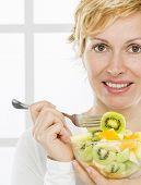 Forty years old woman eats fruit meal