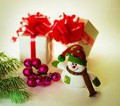 cute snowman with Christmas balls