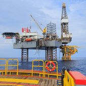 Offshore Jack Up Drilling Rig Over The Production Platform In The Middle Of The Sea
