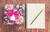 Vintage Gift Box On Wood Background With Notebook And Pencil.