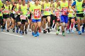 Unidentified marathon runners on the street