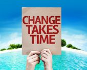 Change Takes Time card with a beach on background