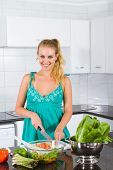 healthy woman making salad