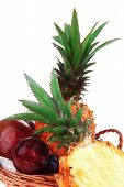 diet food - set of lot of tropical fruits include pineapple plum and mango in small basket isolated over white background