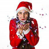 Woman Dressed In Santa Claus Blowing Confetti
