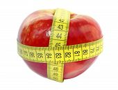 Red Apple And Measuring Tape Isolated On White Background