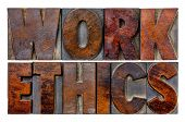 work ethics word abstract in vintage letterpress wood type blocks with ink patina