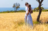 Young couple is standing in the wheat field