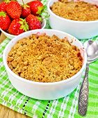 Crumble strawberry on green napkin with berries
