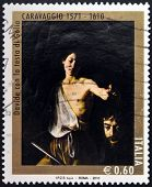 ITALY - CIRCA 2010: A stamp printed in Italy shows David with the Head of Goliath by Caravaggio