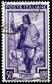 ITALY - CIRCA 1950: a stamp printed in Italy shows Shepherd and Flock Sardegna circa 1950
