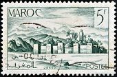 MOROCCO - CIRCA 1949: A stamp printed in Morocco shows fortified city circa 1949