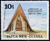 PAPUA NEW GUINEA - CIRCA 1984: A stamp printed in Papua shows opening of parliament house circa 1984