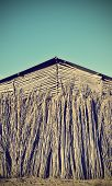 stock photo of tobacco barn  - Facade of an old tobacco farm vintage - JPG
