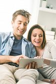Couple Watching Movie On Tablet
