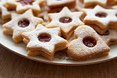 image of linzer  - Closeup of Christmas Linzer cookies on the table very shallow focus