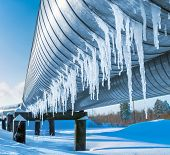 pic of gas-pipes  - Gas pipe in the winter with hanging icicles - JPG