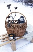 pic of blanket snow  - Basket With Thermos Of Mulled Wine And Knitted Blanket On Sledge In A Snow - JPG