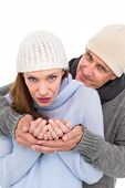 Casual couple in warm clothing on white background