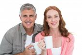 Casual couple having coffee together on white background